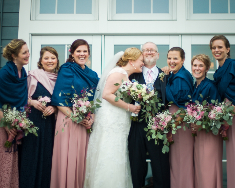 Lucky FotB surrounded by bridesmaids